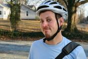 English: A man wearing a bicycle helmet in Durham, North Carolina.