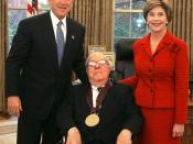 Bradbury receiving the National Medal of Arts award in 2004 with then-President George W. Bush and his wife Laura.