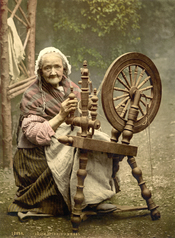 English: Photochrom print of an elderly Irish woman at a spinning wheel. Note: This is a posed nostalgia photograph, since the spinning wheel had gone out of use in almost all practical everyday contexts for a half-century or more by the time this picture