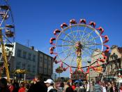 A ride similar to a Ferris wheel, but which inverts its cars and passengers