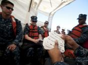 A Sailor embarked aboard USNS Comfort shuffles through French-Creole language cards before arriving in Haiti
