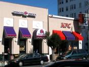 A co-branded Taco Bell/KFC fast food restaurant in San Francisco, California. Yum! Brands often likes to experiment with restaurants that offer products from two or more of its various brands. Photographed by user Coolcaesar on October 16, 2005.