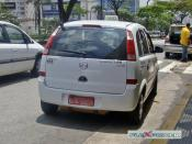 English: Flexible-fuel Chevrolet Meriva used as taxi converted to run also on natural gas (Flex + NGV, or tri-fuel), Sao Paulo, Brazil. The CNG tanks are located underneath in the rear.