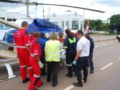 English: Paramedics load a patient into an air ambulance in Pretoria, South Africa