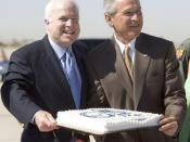 McCain and Dubya Bush enjoy cake as the Gulf Coast drowns, 29 August 2005