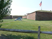 Outside Fort McHenry. Fort McHenry, in Baltimore, Maryland, is a star shaped fort best known for its role in the War of 1812 when it successfully defended Baltimore Harbor from an attack by the British navy in the Chesapeake Bay. It was during this bombar