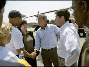 New Orleans Mayor Ray Nagin, Louisiana Governor Kathleen Blanco, President George W. Bush and Louisiana Senator David Vitter meet on the tarmac beside Marine One, September 2 2005.