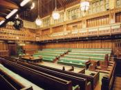 Photograph of the debating chamber of the British House of Commons in the Palace of Westminster, London, looking north-east
