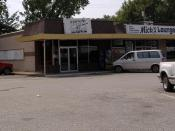 English: Picture of Mick's Lounge in Jeffersonville, site of first Papa John's. Category:Images of Jeffersonville