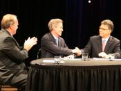 English: Candidates Dean Barkley, Norm Coleman, and Al Franken shake hands at the close of the debate hosted by Breck School.