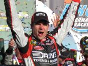 Jeff Gordon with the Subway Fresh Fit trophy in Victory Lane. Photo by Jordan McNerney, AARP.