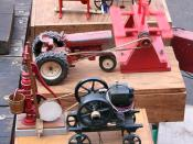 Early internal combustion engines were used to power farm equipment similar to these models.