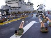 English: At sea aboard USS Bataan (LHD 5) Sept. 24, 2001 -- U.S. Marines assigned to the 26th Marine Expeditionary Unit (26th MEU) start their morning with group exercises on the flight deck aboard USS Bataan. U.S.Navy photo by Photographer's Mate 2nd Cla