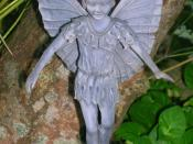 English: A resin statue of a Fairy in natural surroundings. 2007.