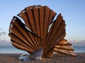 Large sculpture of a scallop on the beach at Aldeburgh, England