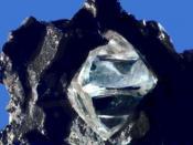 English: Nearly octahedral diamond crystal in matrix.
