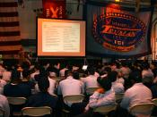 English: Naval Station Norfolk, Va. (Aug. 31, 2004) – Sailors aboard the Nimitz-class aircraft carrier USS Harry S. Truman (CVN 75) attend a Career Development Symposium in the hangar bay aboard ship. The symposium is part of a series of seminars to