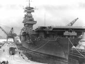 English: The U.S. Navy aircraft carrier USS Yorktown (CV-5) in Dry Dock No.1 at the Pearl Harbor Navy Yard, 29 May 1942, receiving urgent repairs for damage received in the Battle of Coral Sea. She left Pearl Harbor the next day to participate in the Batt