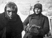 Red Army soldier armed with PPSh-41 marches German soldier into captivity after the Battle of Stalingrad, 1943.