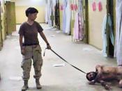 United States Army photo from Abu Ghraib prison in Iraq showing Pvt. Lynndie England holding a leash attached to a prisoner collapsed on the floor, known to the guards as