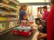 English: Cashier at Wal Mart - Plateros store located in Mexico City. Español: Cajera en el Supercenter de Wal-Mart de Plateros, Ciudad de México