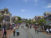 Disneyland's Main Street, U.S.A. with July 4th decorations.