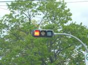 English: A traffic signal with specially shaped lights to assist people with colour blindness. Taken in Halifax, Canada.