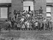English: Original description: Workers in the Tifton Cotton Mills. All these children were working or helping. 125 workers in all. Some of the smallest boys and girls have been there one year or more. Tifton, Ga., 01/22/1909. Photographed by Lewis Hine.