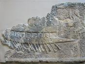 This ship was probably built and manned by Phoenicians employed by Sennacherih. It is a birene, with two rows of oars. Shields are fastened around the superstructure, as on the fortifications of some city walls. The pointed bow is a ram, for holding enemy