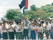 Palestinians marching with Palestine and FSLN flags in 1989