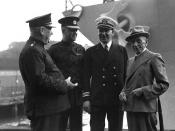 Naval officers standing with William Morris Hughes