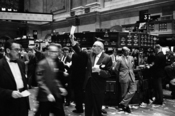 English: Photograph shows stock brokers working at the