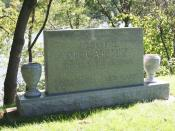 Tombstone of Joseph Raymond McCarthy at St. Mary's Parish Cemetery, Appleton, Wisconsin. The Fox River is in the background.