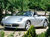 Porsche Boxster, a rear mid-engine, rear-wheel (RMR) drive sports car