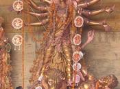 Durga slaying Mahisasur - golden statue. The priest is performing navami arati in front (on festival Durgapuja) (Chittaranjan Park, Delhi, Oct 22, 2004).
