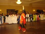 A young Indo-Canadian woman performing Bhangra dancing
