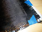 A cloth of woven carbon fiber filaments is commonly used for reinforcement in composite materials.