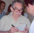 edited image of Gabriel Garcia Marquez, signing in Havana, from an image in the public domain