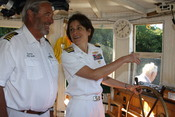 US Navy 110715-N-NT881-141 Rear Adm. Gretchen S. Herbert, commander of Navy Cyber Forces, takes the wheel of the historic boat Mary Jemison