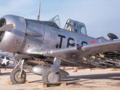 A U.S. Air Force North American T-6 Texan forward air control plane in Korea with underwing phosphor rockets. USAF personnel develped own rockets to visually mark targets: they fabricated rocket rails to attach custom-made rockets -- these rockets were ma