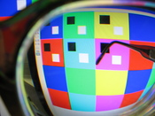 Prismatic color distortion shown with a camera set for nearsighted focus, and using -9.5 diopter eyeglasses to correct the camera's myopia.