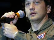 Comedian performs for Aviano Air Base spectators at the USO Holiday Tour 2001 show. The USO produces at least 20 overseas entertainment tours each year, reaching tens of thousands of service men and women. Well-known entertainers volunteer their time to p