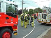 English: New South Wales Fire fighters group up before fighting a house fire.