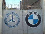 Mercedes and Bmw Symbol On a garage door at Nishapur.