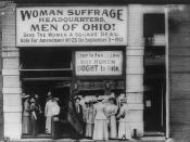 Woman suffrage headquarters in Upper Euclid Avenue, Cleveland--A. (at extreme right) is Miss , President, National League of Women Voters; B. is Judge (holding the flag); C. is Mrs. Malcolm McBride.