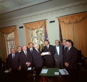 Members of the Warren Commission present their report on the assassination of President John F. Kennedy to President Lyndon Johnson. Cabinet Room, White House, Washington DC. L-R: John McCloy, J. Lee Rankin (General Counsel), Senator Richard Russell, Cong