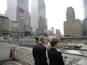 President George W. Bush and Laura Bush look over the World Trade Center site Sunday, September 10, 2006, during a visit to Ground Zero in New York City to mark the fifth anniversary of the September 11th terrorist attacks.