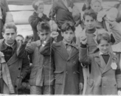 English: The photograph shows children preparing for evacuation from Spain, during the Spanish Civil War, some giving the Republican salute. It is donated to Wikipedia Commons by the estate of Olga Brocca Smith, and is dedicated to all innocent victims of