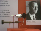 Bottom device: experimental ruby crystal and laser waveguide, 1959. Top device: First laser and its ruby crystal, emitting first light on May 16, 1960. Photograph: Theodore Maiman, who created both devices. Exhibit in National Museum of American History,