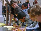 English: A teacher and young pupils at The British Museum Duveen Gallery